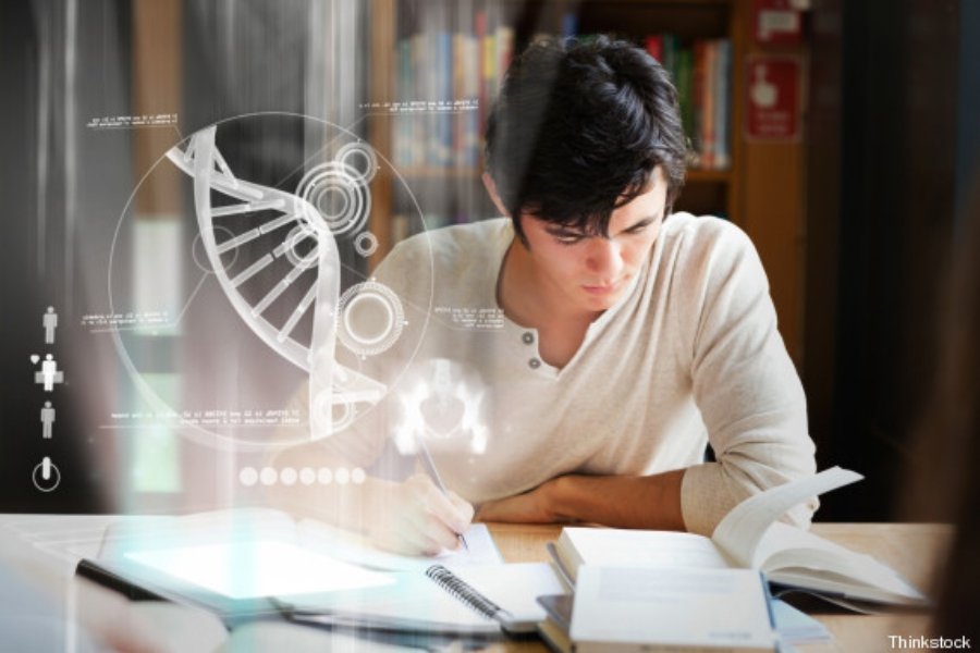 Focused college student analysing dna on digital interface